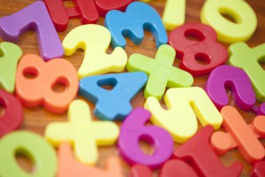 Closeup background of colourful plastic numbers for teaching young children mathematics